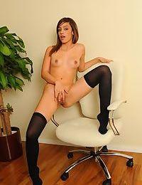 Amateur model Melanie Jane is spreading her legs in sexy stockings