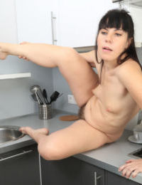 Older woman Malavi Mepanse gets naked in her kitchen to exhibit her hairy bush