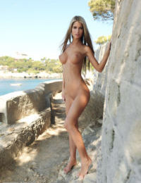 Sultry Nessa poses with her perky big tits naked in the great outdoors