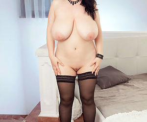 Chubby MILF Joana Bliss uncovers her huge boobs and shaved vagina