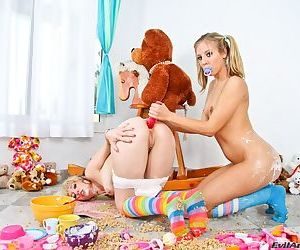 Cute young blondes in socks & diapers squirt milk from their sweet asses