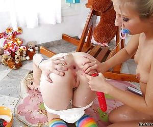 Naughty lesbians making some kinky milky anal action using their toys