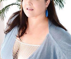 Buxom asian gal Kelly Shibari showcasing her giant jugs and big ample ass
