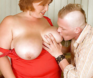 Nikki Cars shows off her big tits to her punky young lover.