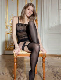 Glamour girl Mila I posing in black nylons after removing see thru lingerie