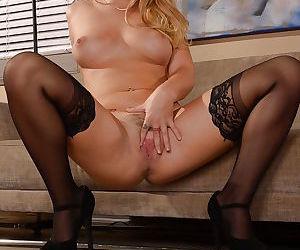 Teenage secretary Jenna Ashley lifting blouse to expose young girl tits