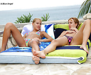 Graceful teenage cuties are into lesbian strapon action outdoor