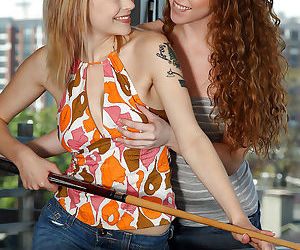 Hot young lesbians with gorgeous bodies having fun with a huge strapon