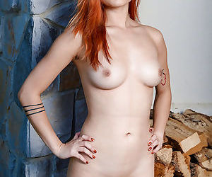 Redhead amateur solo girl Lea Hart baring nice Asian tits and bald vagina