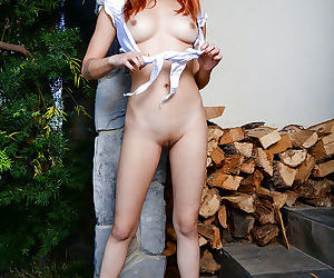 Redhead amateur solo girl Lea Hart baring nice Asian tits and bald vagina