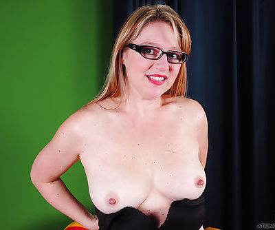 Older blonde woman in glasses Chele undressing for close up pics of pussy