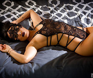 Sultry Asian babe Asa Akira modelling in mask and sexy lingerie