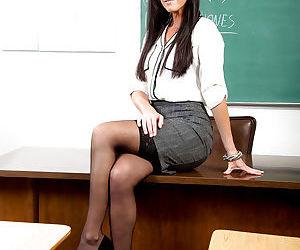 Brunette teacher India Summer removes skirt & lingerie to pose nude on desk
