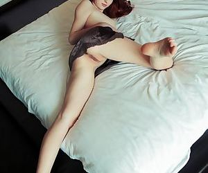 Young redhead Michelle H touting large breasts and shaved vagina