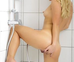 Young blonde girl from Europe masturbates with aid of showerhead spray