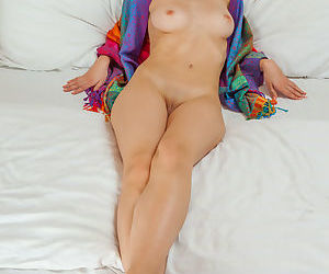Petite babe with tiny boobs spreading shaved vagina for glamour photo shoot