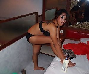 Seductive asian babe taking off her clothes and taking bath