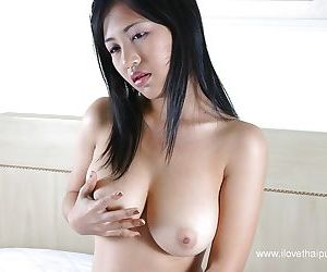 Busty asian babe stripping and sticking a dildo into her hairy twat