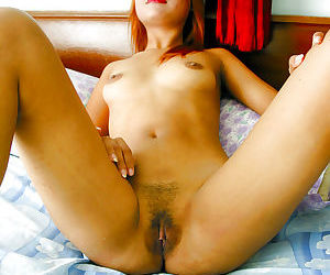 Redhead asian babe with sexy ass exposing her fuckable body