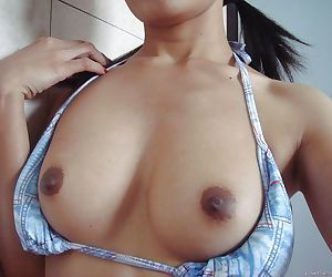 Sweet asian babe exposing her nice titties and fingering her hairy cunt