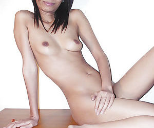 Skinny thai babe with tiny tits and slender legs stripping on the bed