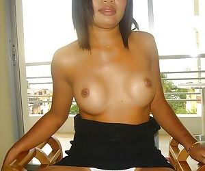 Seductive asian babe showing off her titties and teasing her cunt