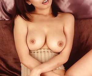 Asian babe with amazing natural boobs masturbating her bushy twat