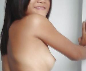Young asian babe with small tits stripping and showing off her juicy twat