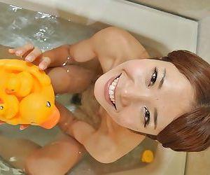 Adorable asian babe Wakana Asada getting naked and taking bath