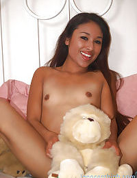 Asian teen Cali shows her tiny tits and spreading legs and ass
