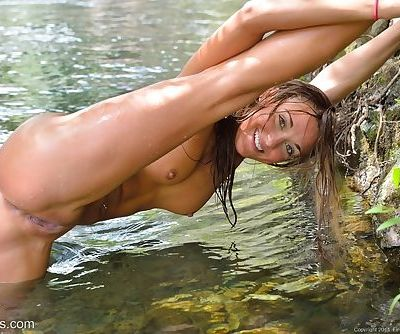 Young girls with small tits showing wet shaved pussy & tight ass in the river