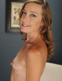 Aged redhead Cindi Thompson strips naked to pose in buff for first time