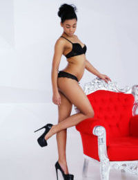 Skinny black babe freeing tiny teen tits from lingerie for glamour spread