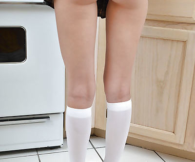 Teen babe Emily G reveals her tight ass in a sweet skirt while in kitchen