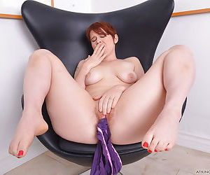 Mature redhead Lily Cade slips off panties to reveal hairy vagina