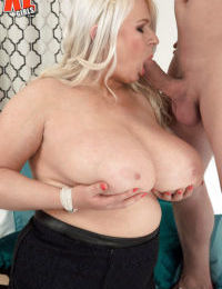 Chunky blonde woman Samantha Sanders fondling massive boobs while licking cock