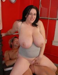 Buxom older dame Kitty exposing massive saggy melons in gym
