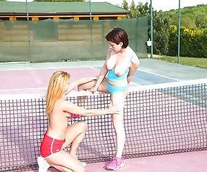 Young dyke Anabelle and her girlfriend tongue kissing on tennis court