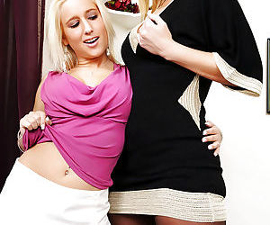 Older and younger blonde females strip for lesbian play on sofa