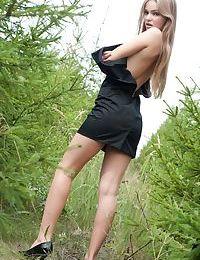 Gorgeous brunette minx Bridgit unveils her steaming hot slim body