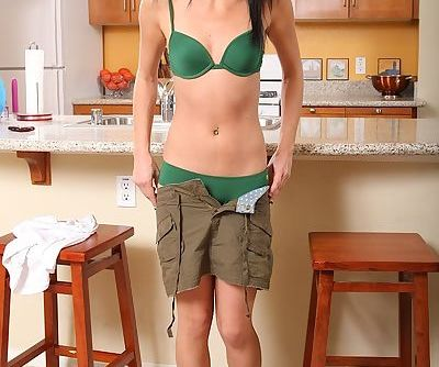 Lingerie model Stephanie Sage is showing her body in green underwear