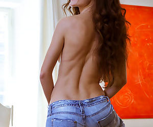 Teen babe shedding ripped jeans on way to spreading shaved vagina