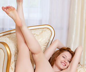 Sexy young redhead Dariya reveals her small tits and her hairy twat