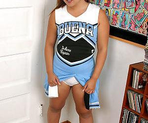 Amateur Latina cheerleader Kylie Rey exposing pierced vagina beneath skirt