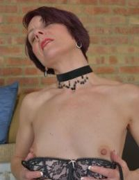 Mature mom Penny Brooks shed her finery to spread her sexy pussy lips