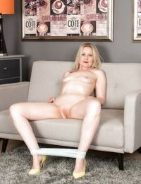 Mature broad Emma Turner strips off clothing to show off her wide open pussy