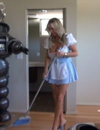 Hot housewife in sexy maid uniform revealing her jugs and toying her cunt