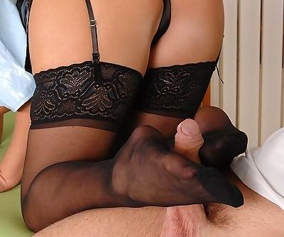 Sexy chick in stockings Debbie White gets nailed and gives a footjob