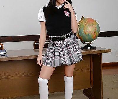 Schoolgirl Megan Rain poses in short skirt and knee high white socks