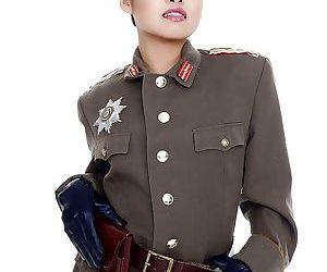 Oriental pornstar Cindy Starfall posing solo in military garb